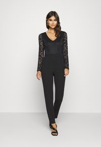 Anna Field - OCCASION - LONG SLEEVES LACE TOP JUMPSUIT - Combinaison - black - 0
