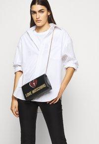 Love Moschino - EVENING BAG - Across body bag - black - 0