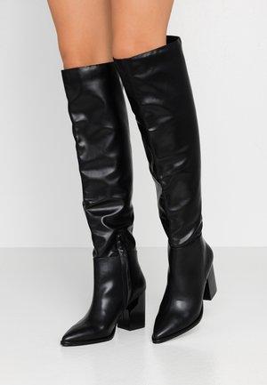 High heeled boots - black