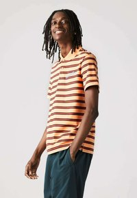 Lacoste - Polo shirt - hell orange/rot - 1