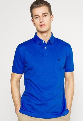 1985 - Poloshirt - bio blue
