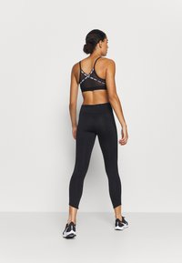 Nike Performance - FAST - Legginsy - black