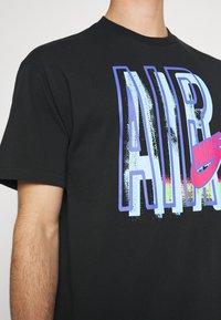 Nike Sportswear - TEE AIR LOOSE FIT - T-shirt med print - black - 4