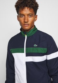 Lacoste Sport - SET - Dres - navy blue/white/green/wasp - 6