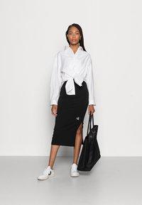 Calvin Klein Jeans - MICRO MONOGRAM KNIT TUBE SKIRT - Pencil skirt -  black - 1