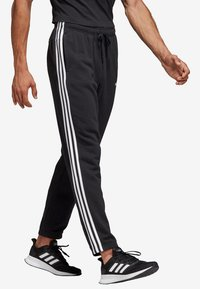 adidas Performance - ESSENTIALS 3STRIPES FRENCH TERRY SPORT PANTS - Tracksuit bottoms - black - 3