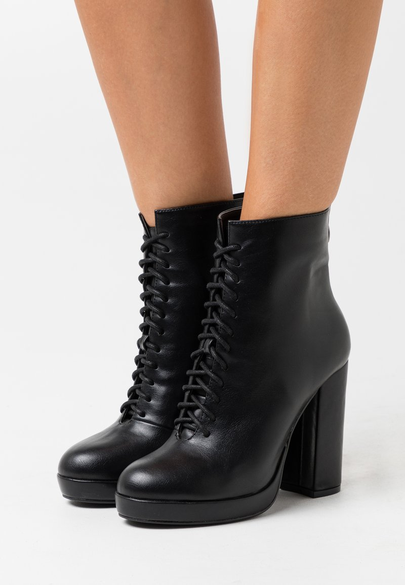 KHARISMA - Kotníková obuv na vysokém podpatku - nero