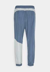 Hummel - HMLSULLIVAN PANTS - Tracksuit bottoms - china blue - 1