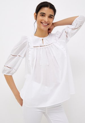 WITH OPENWORK EMBROIDERY - Blouse - white