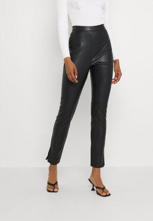 SPLIT UP PANTS - Trousers - black