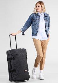Eastpak - TRANVERZ - Wheeled suitcase - black denim - 0