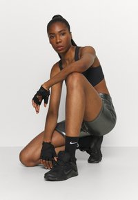 Nike Performance - AIR BRA - Medium support sports bra - black/reflective silver - 3