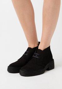 Clarks Originals - ARISA DESERT - Platform ankle boots - black - 0