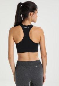 ONLY Play - ONPDAISY SEAMLESS BRA - Sports bra - black - 2