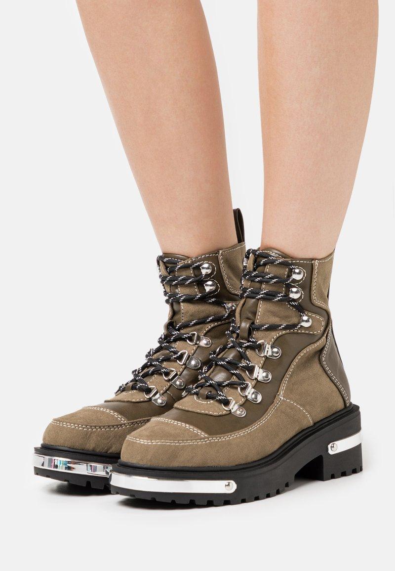 River Island - Platform ankle boots - khaki dark