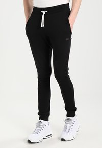 Produkt - PKTVIY BASIC - Tracksuit bottoms - black - 0