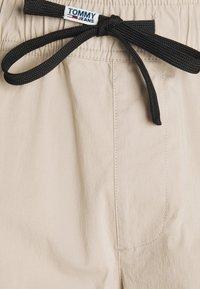 Tommy Jeans - SCANTON - Cargo trousers - beige - 5