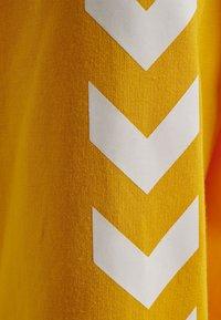 Hummel - HMLGO - Sweat à capuche zippé - sports yellow - 4