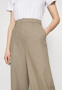 Gestuz - GRITA PANTS - Trousers - sand/black - 3