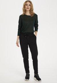 Kaffe - KALORA  - Trousers - black deep - 1