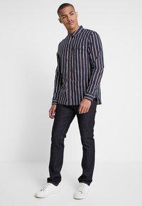 Nudie Jeans - GRIM TIM - Straight leg jeans - dry true navy - 1
