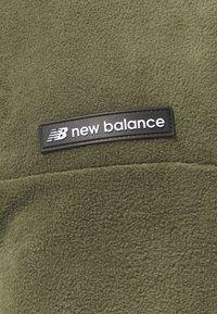 New Balance - SPORT STYLE POLAR PANT - Tracksuit bottoms - olive - 2