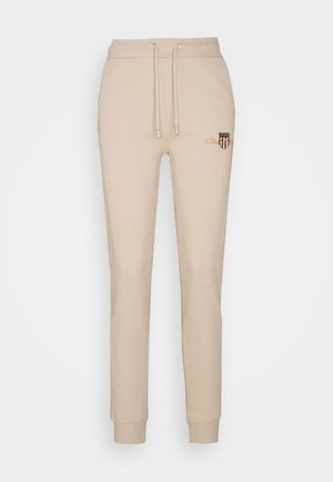 ARCHIVE SHIELD PANT - Tracksuit bottoms - dry sand