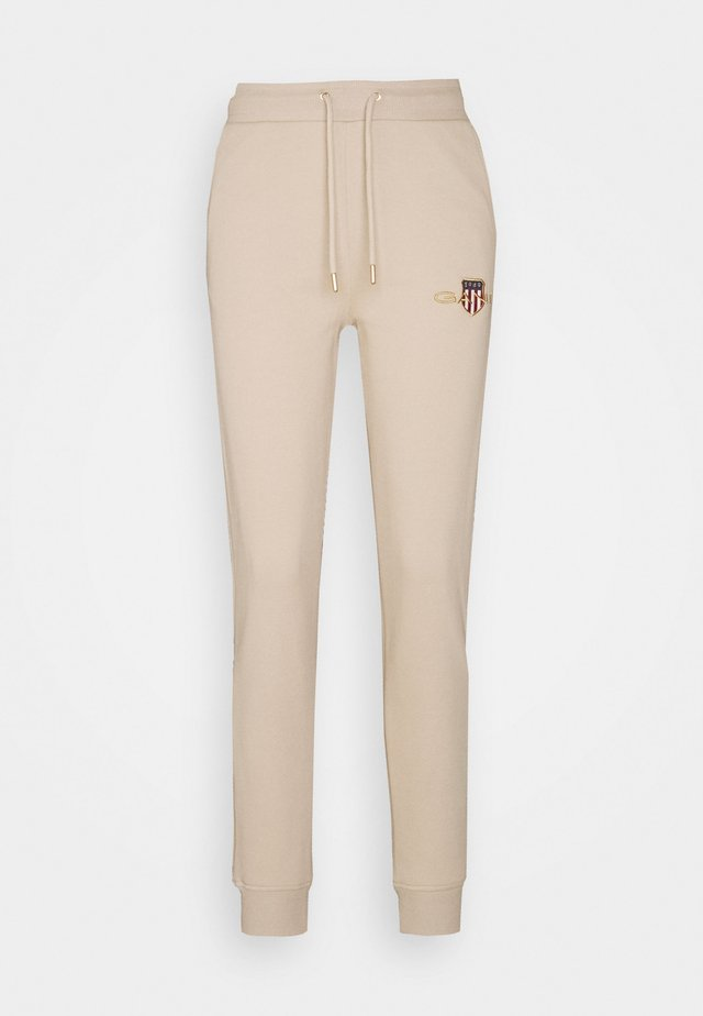 ARCHIVE SHIELD PANT - Trainingsbroek - dry sand