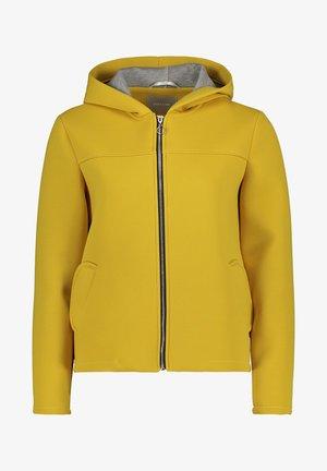 Sweater met rits - lemon curry