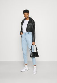 Levi's® - HIGH WAISTED TAPER - Jeans Tapered Fit - light-blue denim - 1