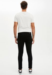 DeFacto - Slim fit jeans - black - 2