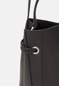 HUGO - VICTORIA DRAWSTRING - Across body bag - black - 4