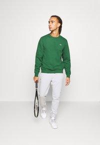 Lacoste Sport - Pantalones deportivos - calluna - 1