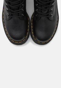 Dr. Martens - JADON FAUX FUR LINED - Platform ankle boots - black pisa - 5