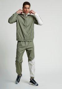 Hummel - SULLIVAN - Waterproof jacket - vetiver - 1