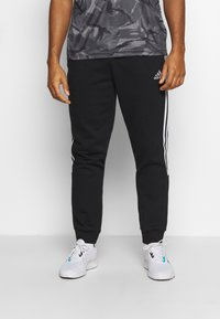 adidas Performance - CUT - Spodnie treningowe - black/white - 0