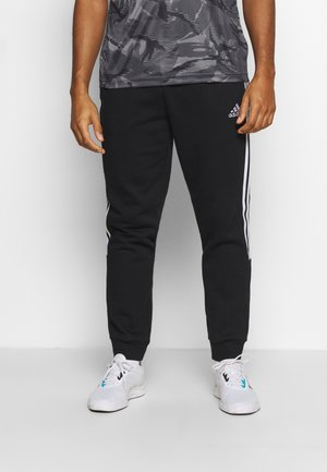 CUT - Tracksuit bottoms - black/white