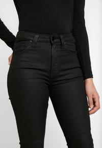 Nudie Jeans - HIGHTOP TILDE - Jeansy Skinny Fit - painted black - 5