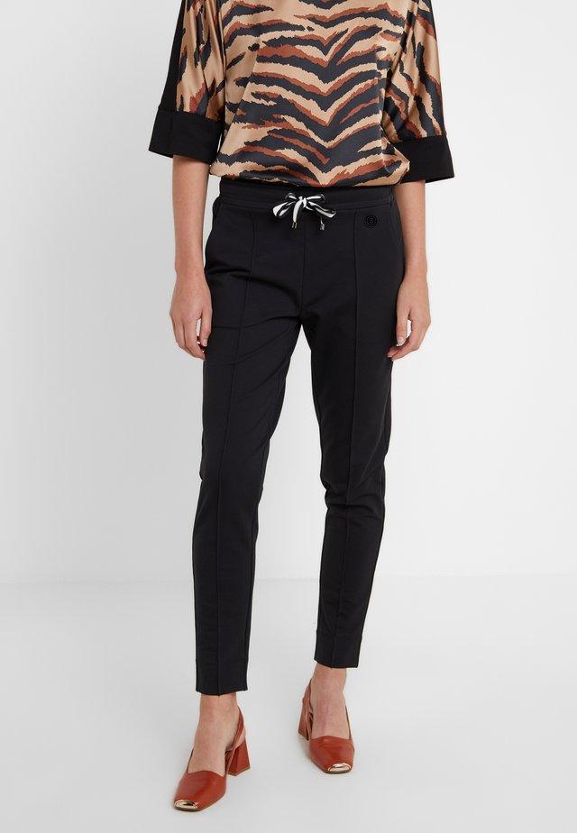CARA - Pantalones deportivos - black