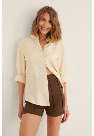 SEAM DETAIL - Shorts - brown
