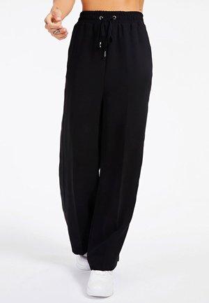 MIT LOGO - Spodnie materiałowe - schwarz