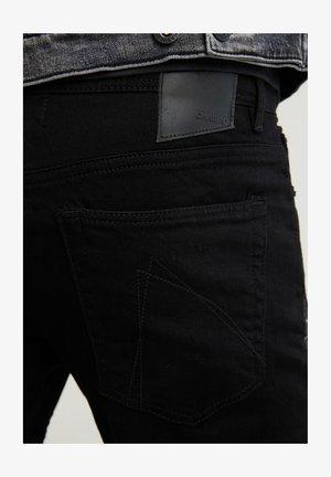 CARTER KALI - Slim fit jeans - black