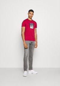 Diesel - D-LUSTER - Slim fit jeans - grey denim - 1