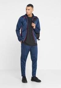 Uhlsport - ESSENTIAL CLASSIC - Tracksuit - blue/red - 1