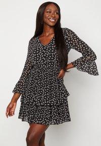 Bubbleroom - CARLOTTA FLOUNCE - Jersey dress - black/ white - 0