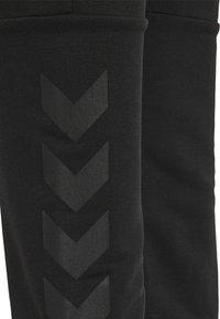 Hummel - Tracksuit bottoms - black - 5