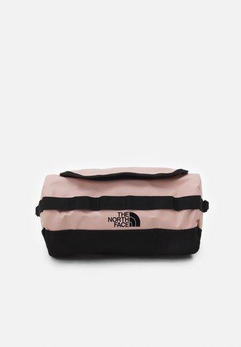 TRAVEL CANISTER UNISEX - Wash bag - light pink/black