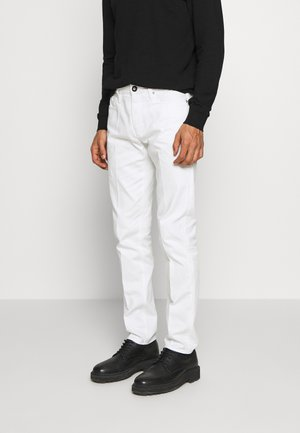 TASCHE TESSUTO - Jeans slim fit - bianco neve