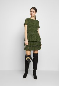 MICHAEL Michael Kors - MINI TIER DRESS - Day dress - black/evergreen - 1