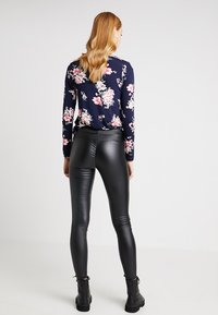 KIOMI - Leggings - Trousers - black